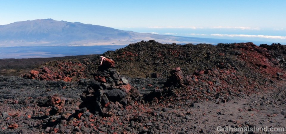 The lava comes in many colors, seen here where the trail crosses the road.