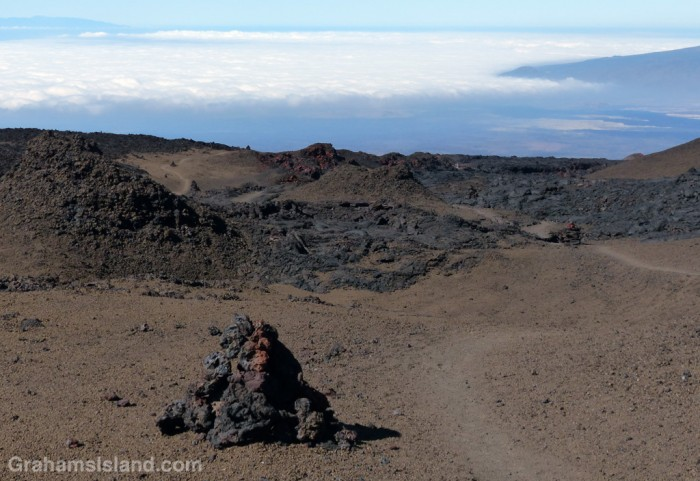 Clouds hang over the west side of the saddle between Mauna Loa and Mauna Kea.