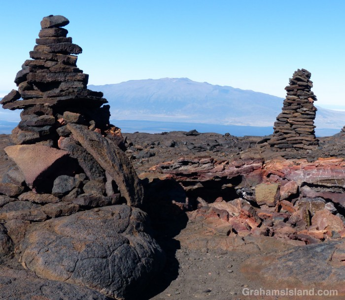 These two big cairns mark a collapsed lava tube.