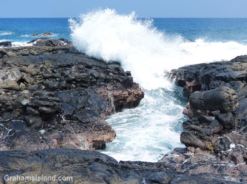 Waves crash ashore near Mano Point