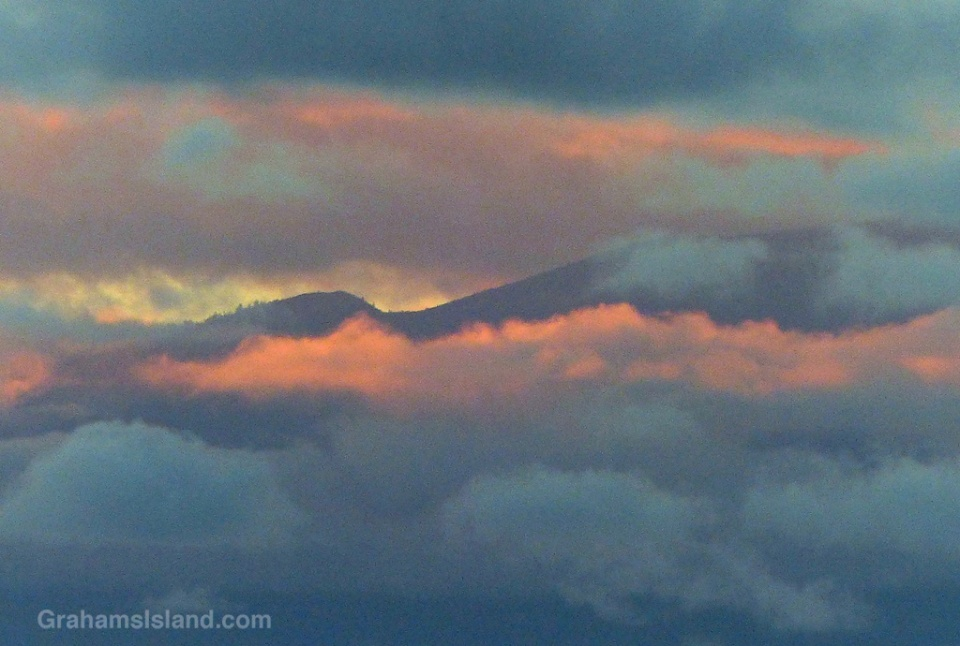 The hills of Maui seen through evening clouds.