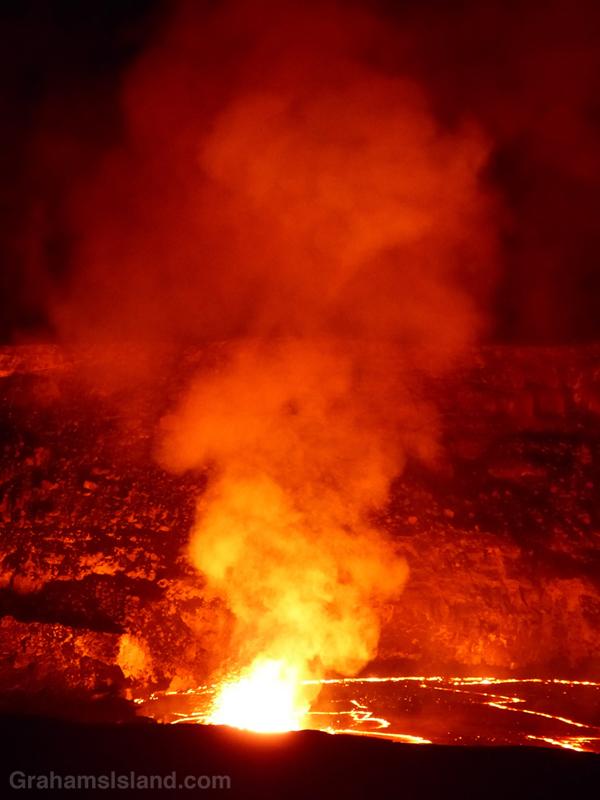 A hotspot illuminates the crater wall at Kilauea