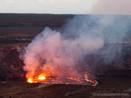 As darkness dissipates, lava shoots into the air.