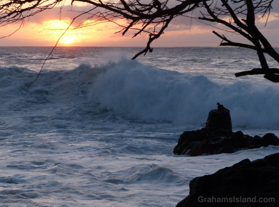 Surf rolls in as the sun sets