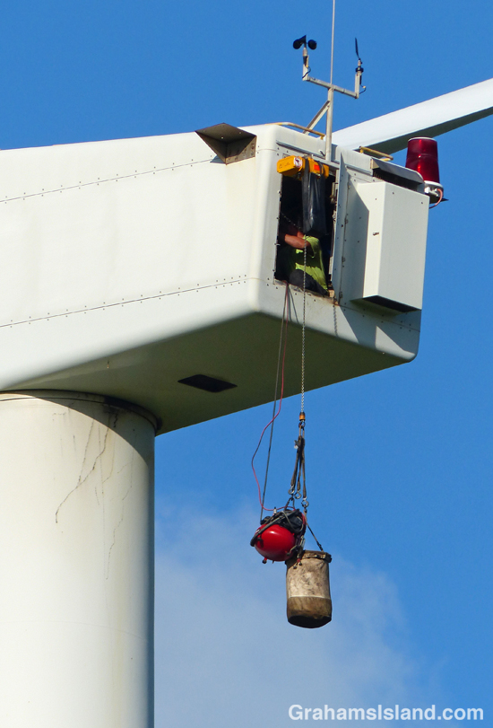 A tech works on a wind turbine.