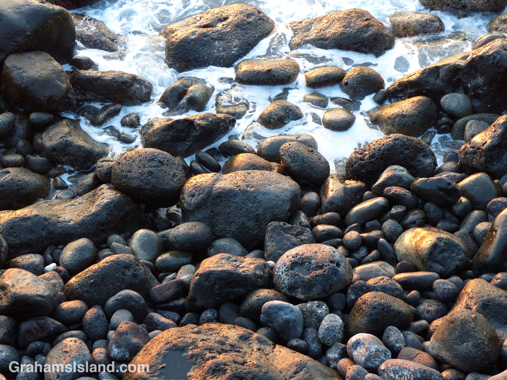 Light reflects off wet rocks