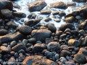 Light reflects off wet rocks