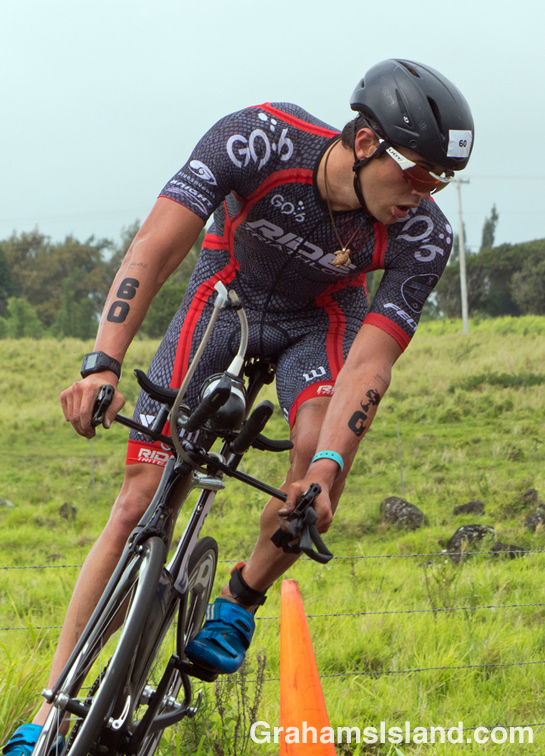 A cyclist make the turn at Hawi in the IRONMAN 70.3 Hawaii race on the Big Island.