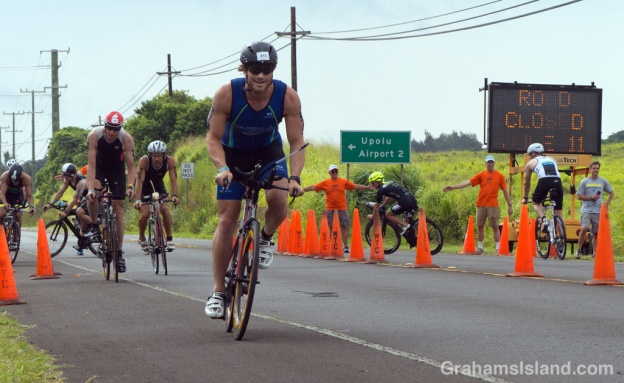 Cyclists make the turn at Hawi in the IRONMAN 70.3 Hawaii race on the Big Island.