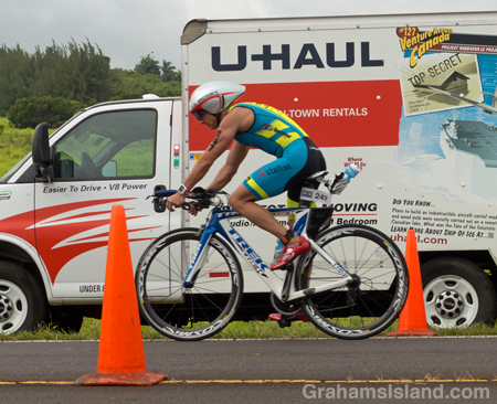 A cyclist approaches the turn at Hawi in the IRONMAN 70.3 Hawaii race on the Big Island.