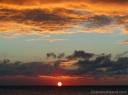The sun slips into the sea off the Big Island.