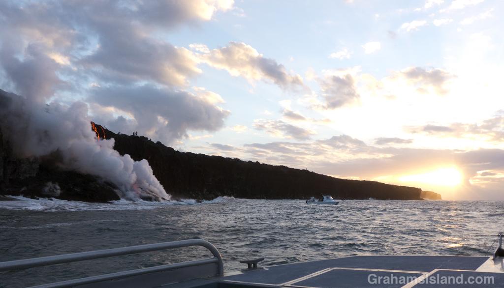 Kilauea lava pours into the ocean at sunrise