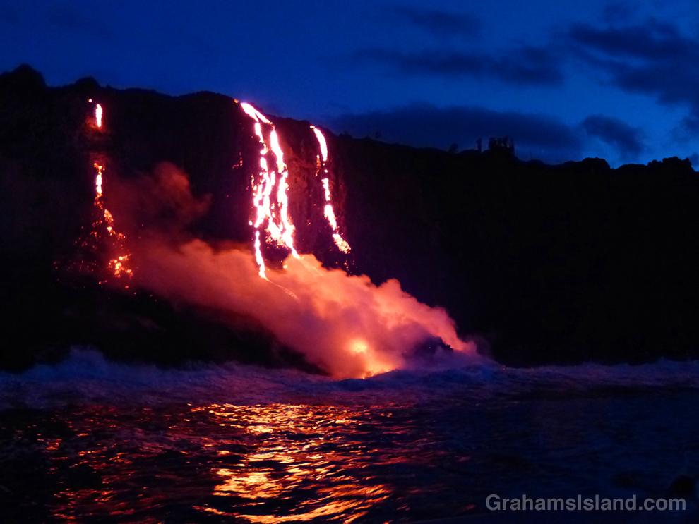 Kilauea lava reaches the ocean in the pre-dawn light.