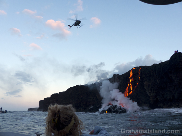 A USGS helicopter checks the progress of Kilauea lava reaching the ocean.