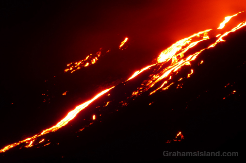 Kilauea's Pu'u O'o flow glows brightly as darkness falls.
