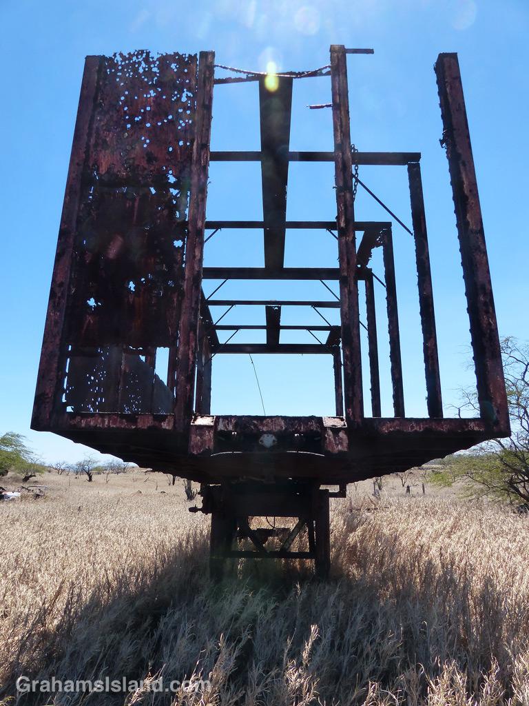 An old trailer rusts away in a field near the Kohala coast.