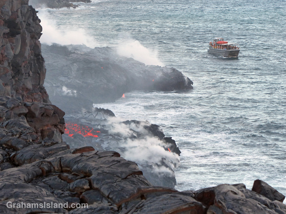 The Lava Ocean tour boat edges up to the new bench in the ocean, created by the flow from Kilauea volcano.