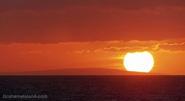The sun sets behind Kahoolawe island