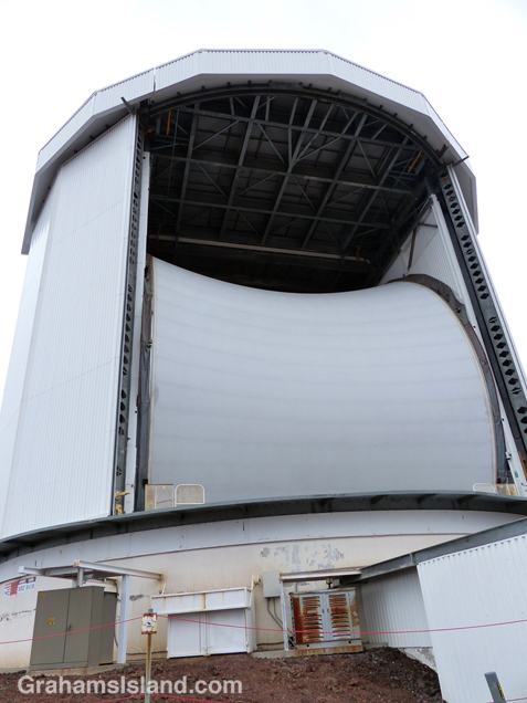 The JCMT from the outside with its huge Gore-Tex tarp curving up and in. The tarp protects the dish from wind and blown sand. It also reflects visible and near-infrared radiation which allows for daytime observations.
