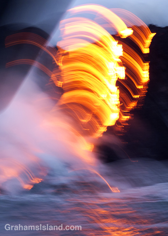 An image of lava from Kilauea Volcano's Pu'u O'o vent entering the sea, taken from a rolling boat.