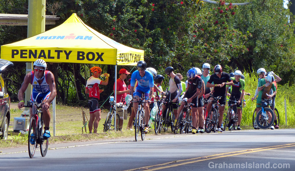 IRONMAN competitors pull over to wait out time penalties they've been given by race marshals