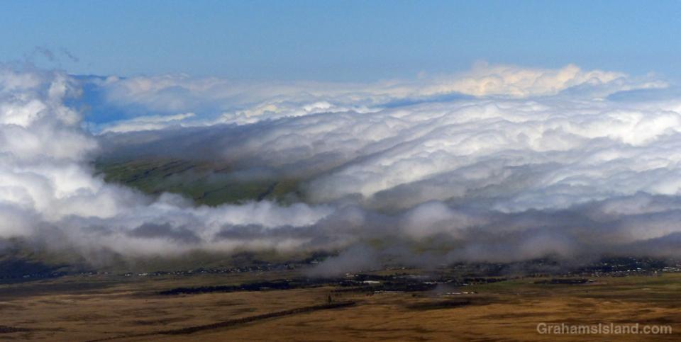 A blanket of cloud climbs over the Kohala Mountains and Waimea