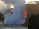 Lava from Kilauea Volcano's Pu'u O'o vent enters the ocean as if from a firehose.
