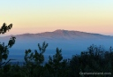 This is Hualalai volcano soon after sunrise, as seen from the western slope of Mauna Kea.