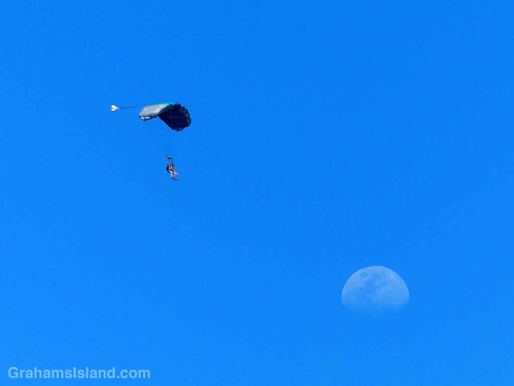 These skydivers appear head for the moon.