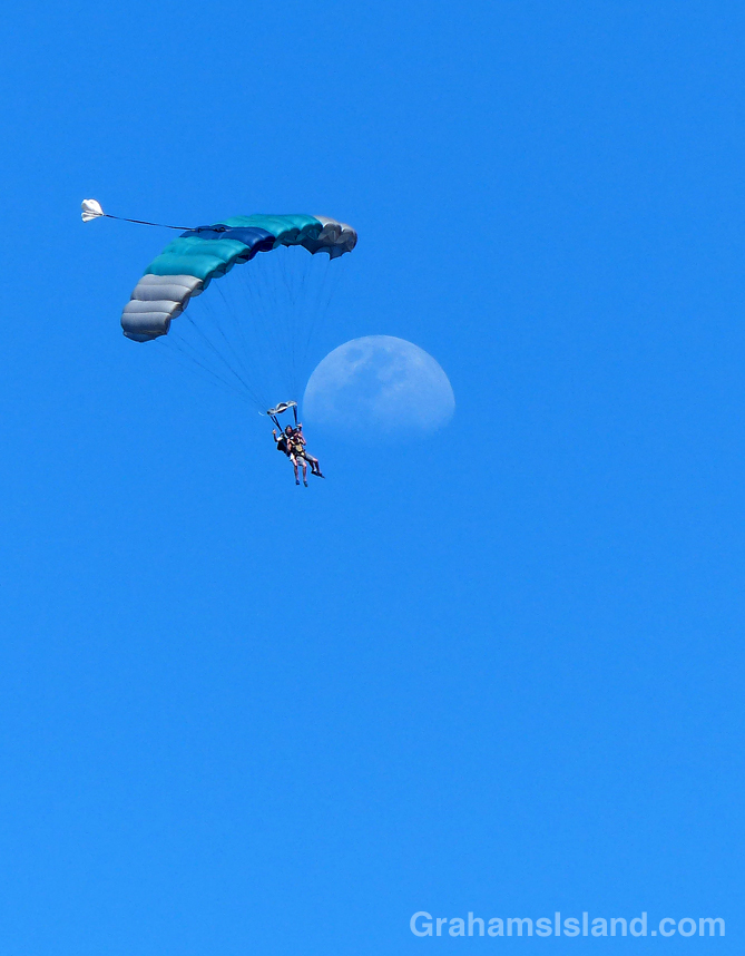 These skydivers appear to have just missed the moon.