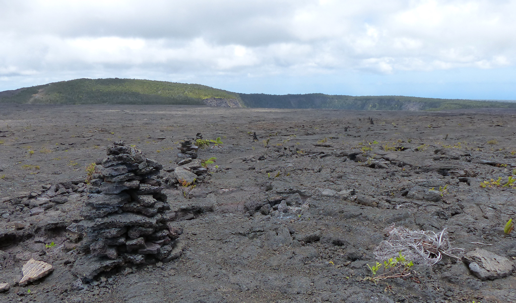 Cairns mark the route across an ocean of lava toward Makaopuhi Crater.