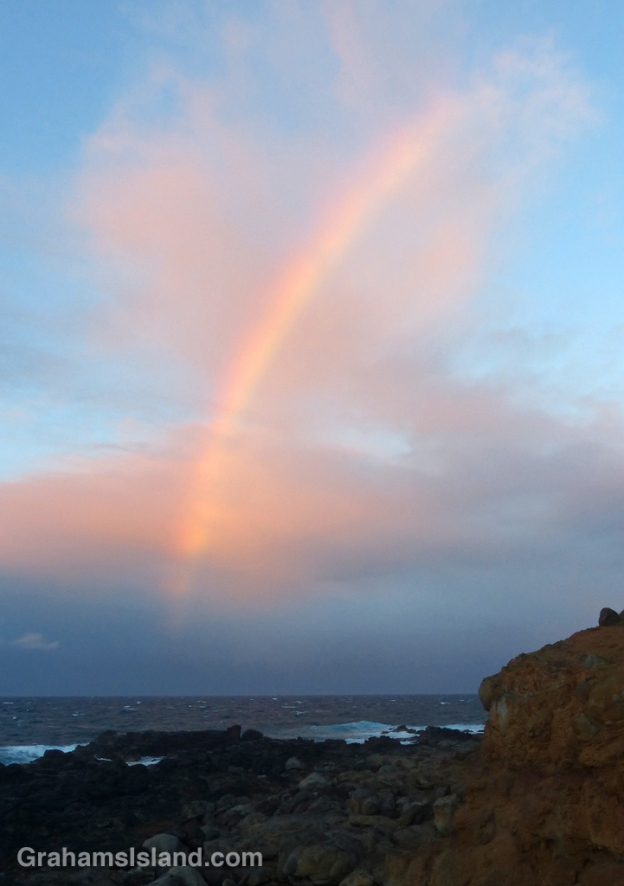 A slice of rainbow, backed by pink clouds