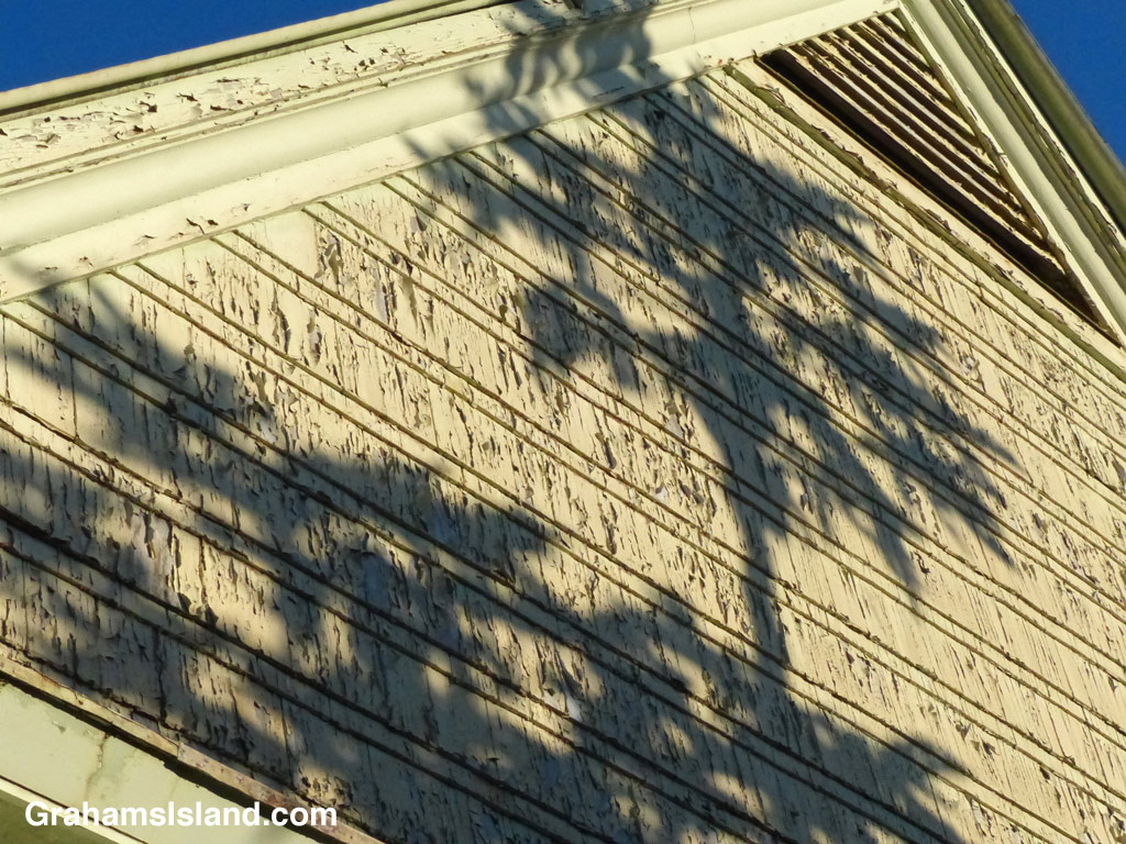 Shadows play on a peeling surface of the old Bond Library in Kapaau.