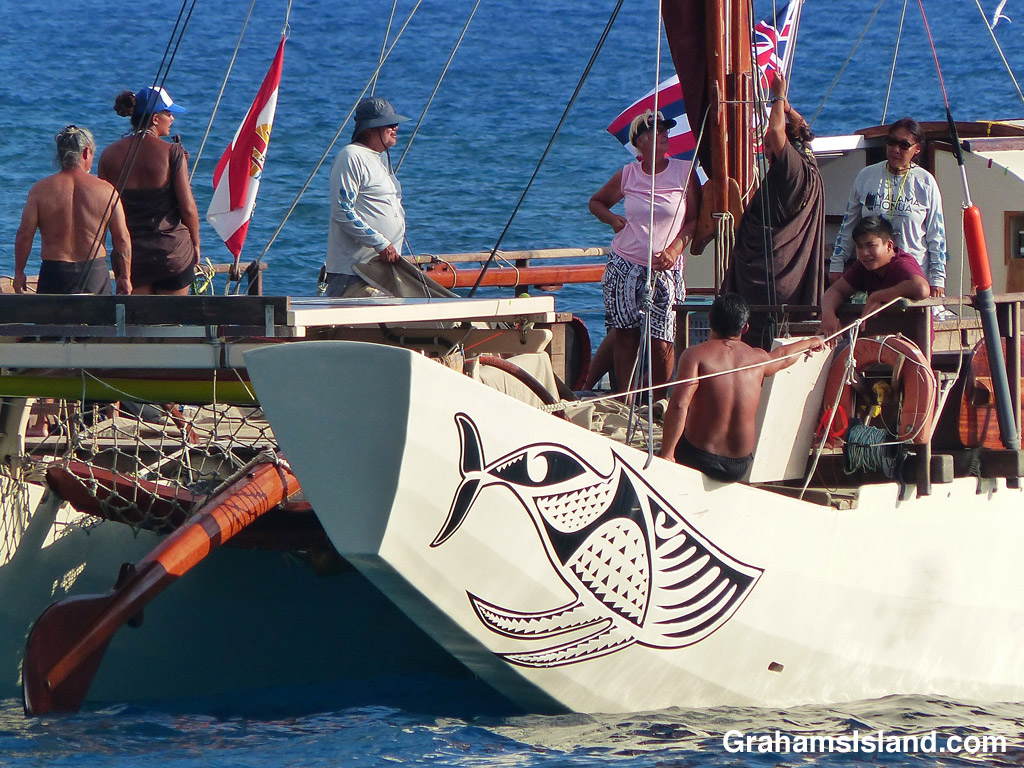 The Tahitian voyaging canoe Fa'afaite off the coast of the Big Island of Hawaii.