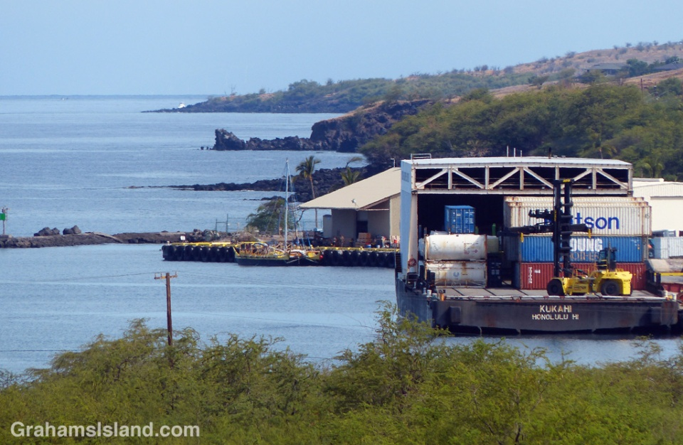An inter-island barge and Hawaiian voyaging canoe Makali'i at Kawaihae harbor.