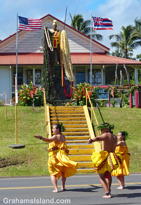 A hula group performs on front of the statue of King Kamehameha 1 in Kapaau
