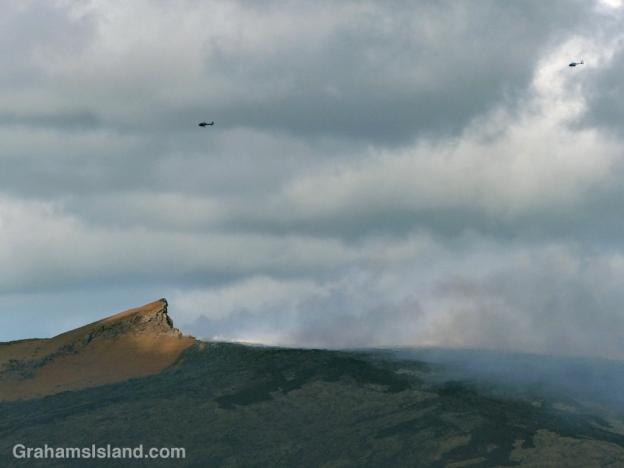 Tour helicopters circle Pu'u O'o vent on the Big Island of Hawaii