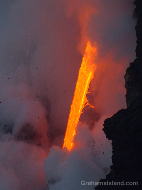 Lava from Kilauea's Pu'u O'o vent pours into the ocean.