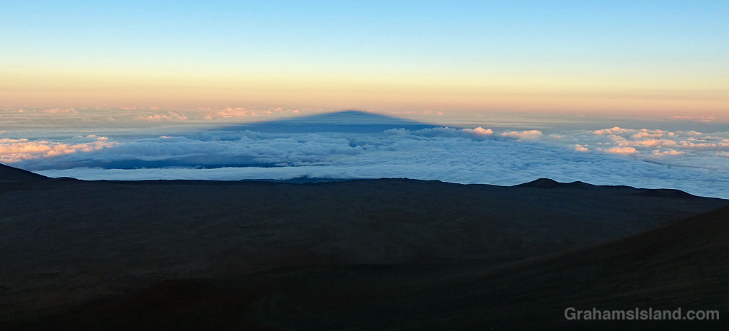 The shadow of Mauna Kea stretches out above the clouds.