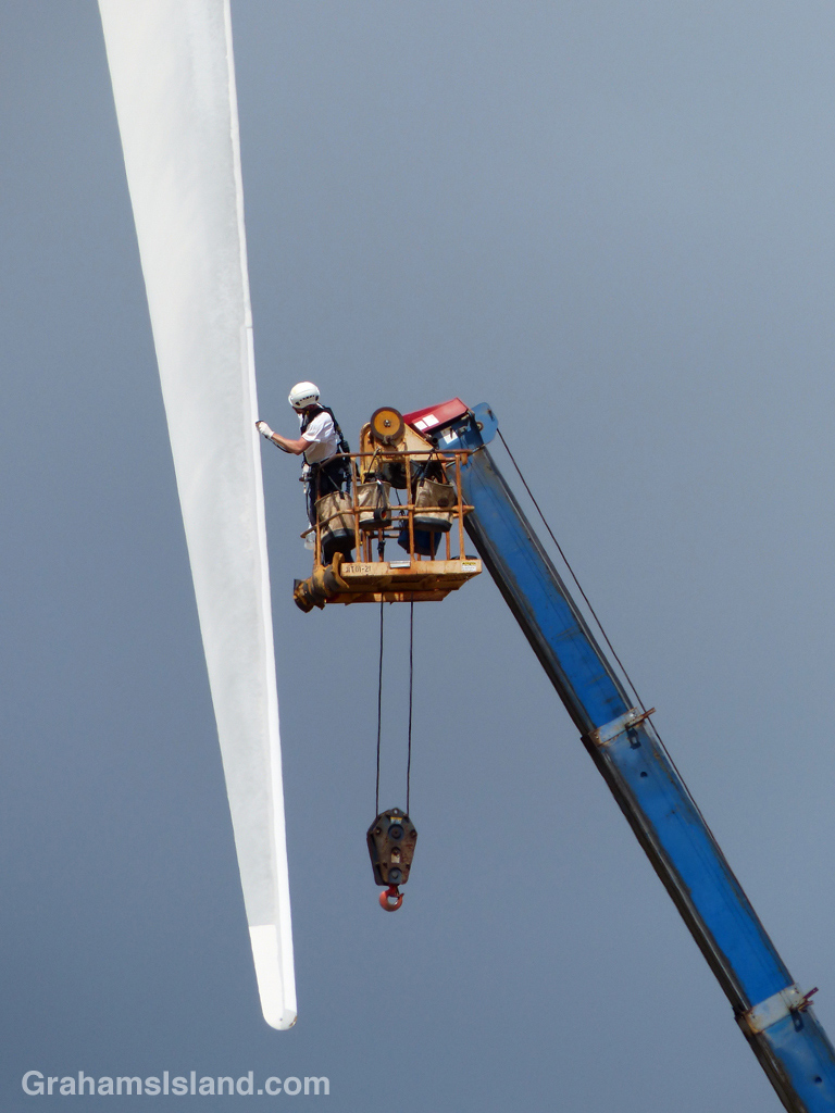 A worker checks out a turbine blade at Hawi Wind Farm.