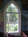 A view through a window of the Painted Church at Honaunau