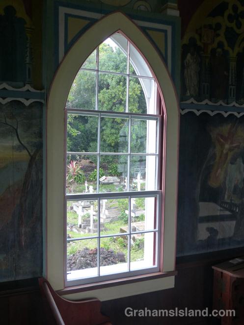 A view through a window of the Painted Church at Honaunau