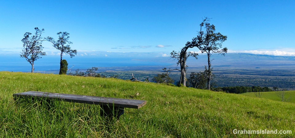 This bench is one of two on the summit of Puu Waawaa, and this is the view looking north toward the coast and the Kohala mountains.