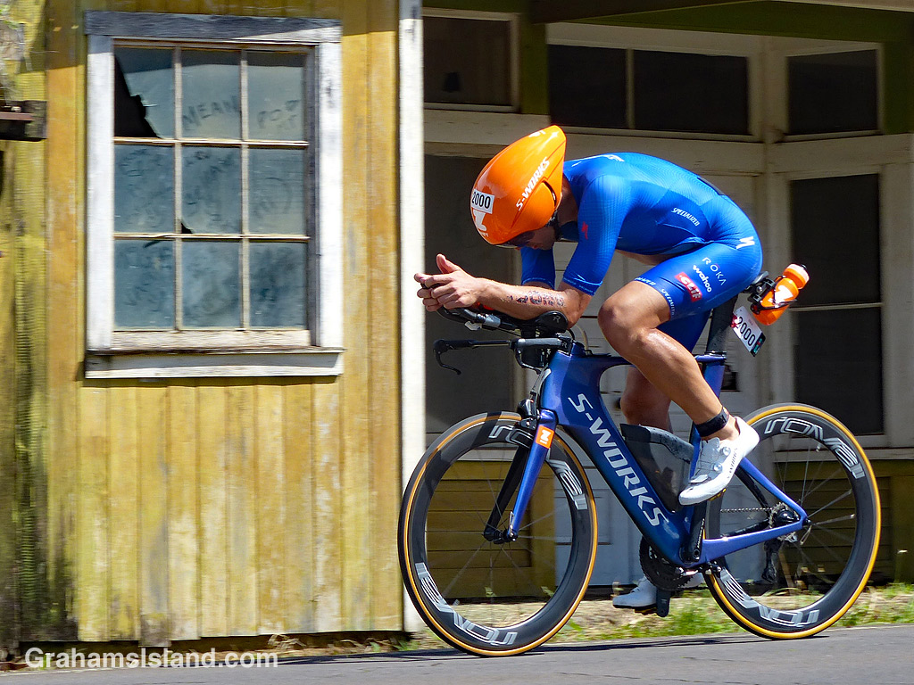 Ironman cyclist and old shed