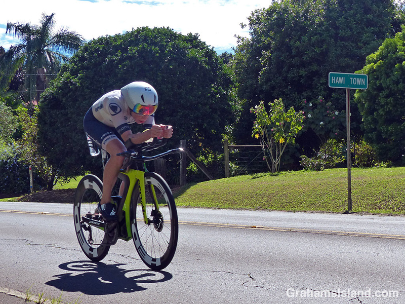 Ironman cyclist leaving Hawi