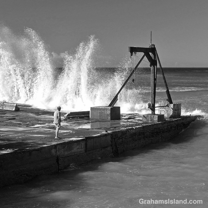 Black and white photo of a wharf on the coast of Hawaii