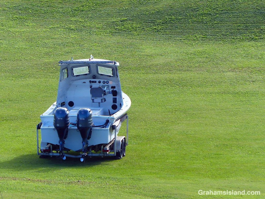 A boat sitting on a lawn