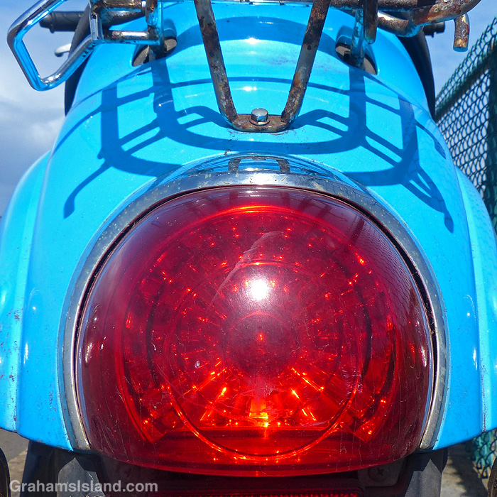 A close up of taillight of a Honda Metropolitanscooter