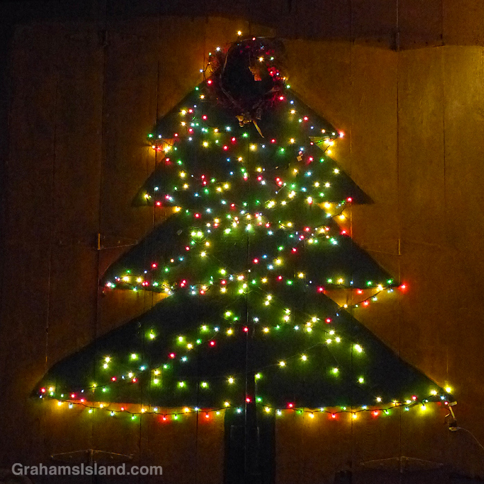 A wooden Christmas tree with illuminations