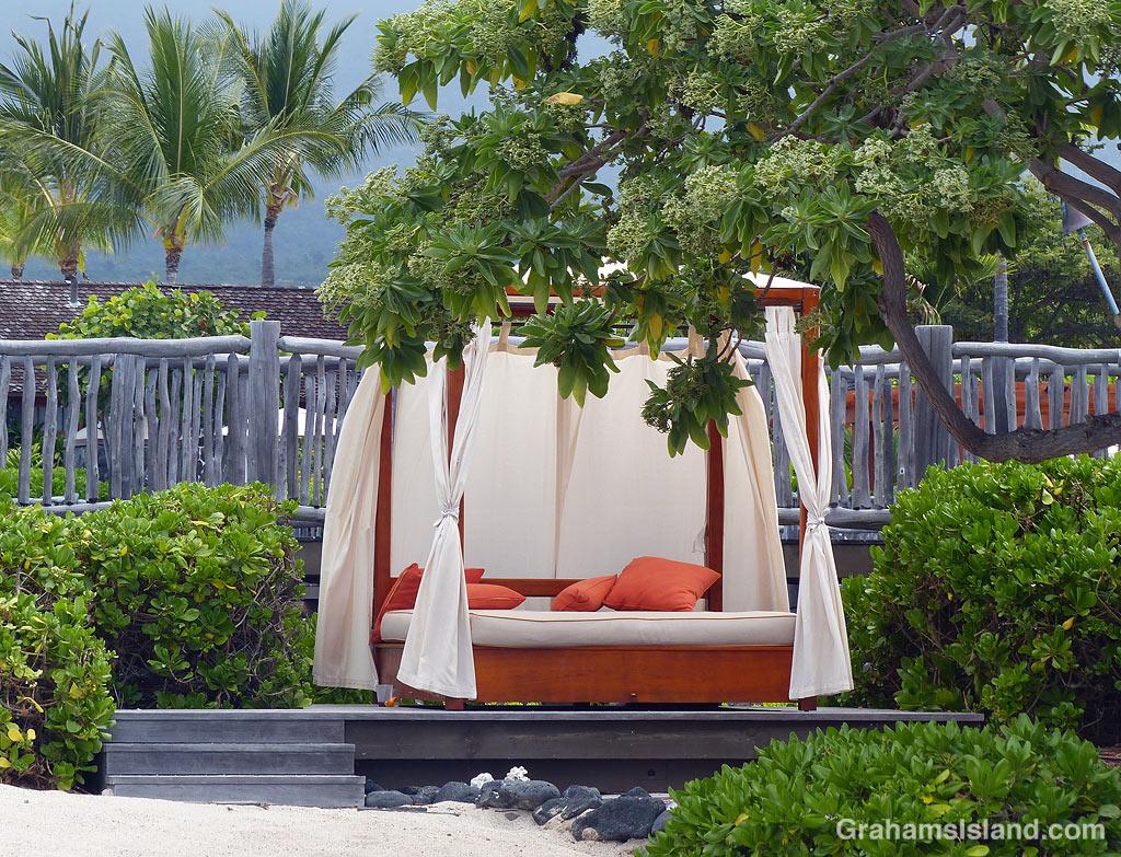 A curtained bed at Kohanaiki Beach Club, Hawaii